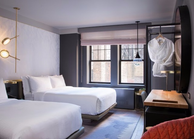 Stylish nyc hotel steps from times square save up to 70 for Stylish hotel rooms